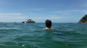 Swimming to a boat