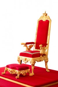 Golden imperor's throne made from gold and red velvet